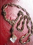 Collier volute, roses & papillon